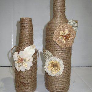 2 JUTE WRAPPED WINE BOTTLES/VASE. BURLAP FLOWERS.